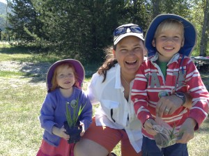 Ethnobotanist Dr. Brenda Beckwith (pictured here with her young friends and fellow camas lovers, Amelia and Benjamin Stewart) at Camas Discovery Day 2013.